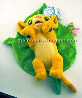 Baby Simba is wrapped in a leaf blanket fastened by a butterfly velcro