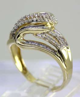 SHIMMERING .85CT 100 ROUND BAGUETTE DIAMOND YELLOW GOLD 4 ROW WAVE