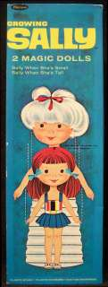 Growing Sally 2 Magic Paper Dolls   Clothes Stands Scissors
