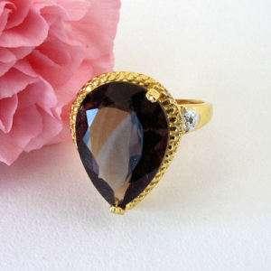 Elegant 9 Ct Pear Shaped Topaz Diamond Accent Ring